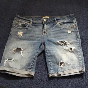 Distressed bermuda shorts with cuffed bottoms